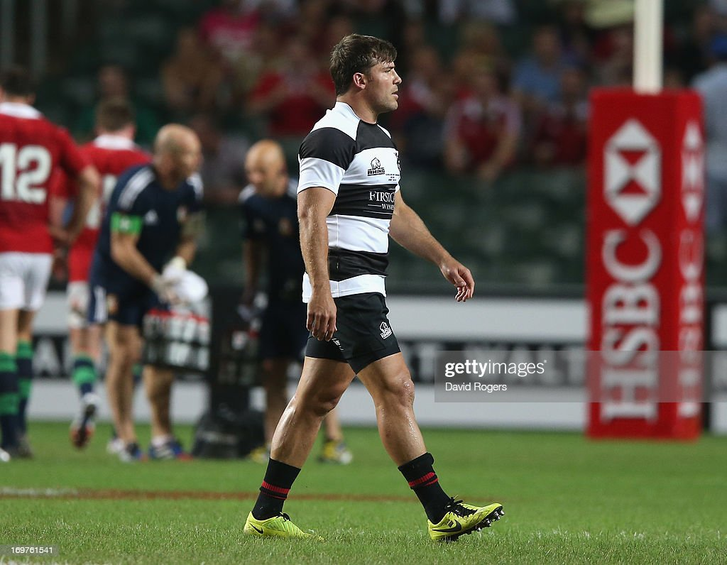 Schalk Brits the Barbarians hooker walks off the field after being shown the yellow card for striking Owen Farrell during the match between the...