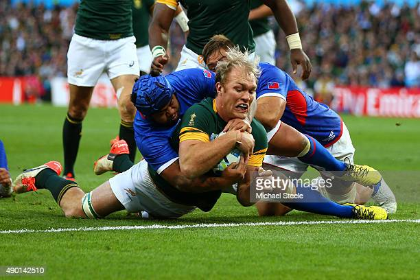 Schalk Burger of South Africa goes over to score his teams third try during the 2015 Rugby World Cup Pool B match between South Africa and Samoa at...