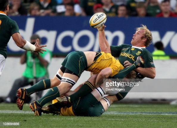 Schalk Burger of South Africa is tackled by David Pocock during the 2010 TriNations match between the South African Springboks and the Australian...