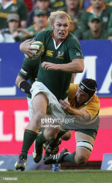 Schalk Burger of South Africa powers away from Dan Vickerman of Australia during the 2007 Tri Nations match between South Africa and Australia at...