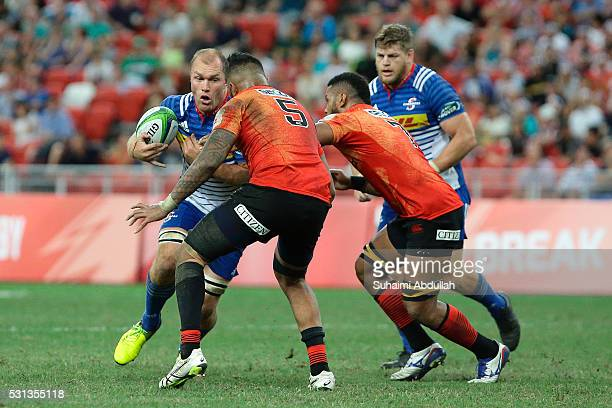 Schalk Burger of Stormers tries to get past Fa'atiga Lemalu of Sunwolves during the round 12 Super Rugby match between the Sunwolves and Stormers at...