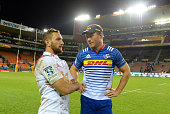 Schalk Burger of the Stormers and Aaron Cruden of the Chiefs speak during the Super Rugby Quarter Final match between the DHL Stormers and Chiefs at...