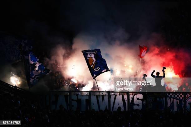 Schalke 04 fans set off some flares during the Bundesliga match between FC Schalke 04 and Hamburger SV at VeltinsArena on November 19 2017 in...