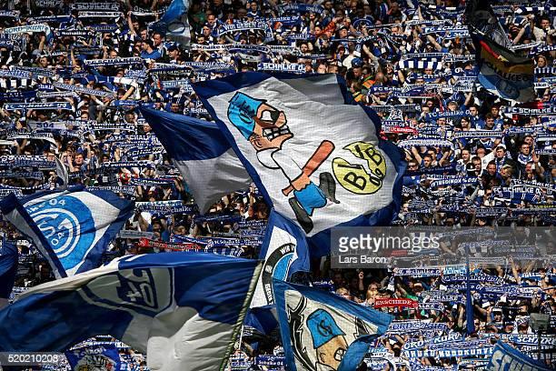 Schalke 04 fans show their support before the Bundesliga match between FC Schalke 04 and Borussia Dortmund at VeltinsArena on April 10 2016 in...