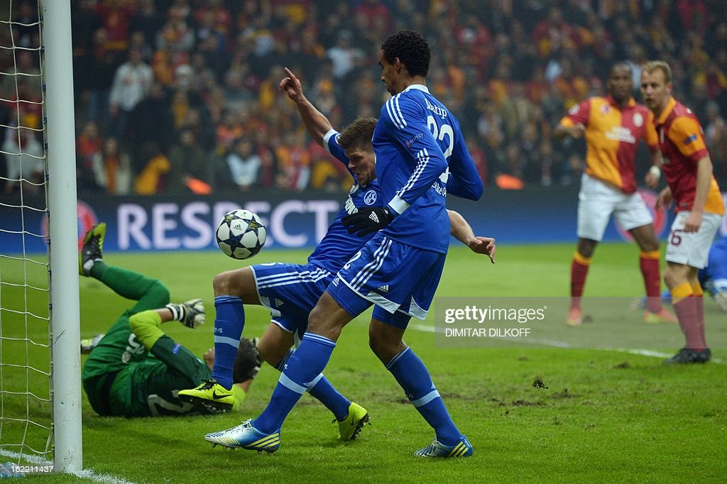 FC Schalke 04 forward Klaas-Jan Huntelaar (C) and FC Schalke 04 defender Joel Matip (R) miss a goal opportunity during the UEFA Champions League football match Galatasaray vs FC Schalke 04 at the Ali Samiyen stadium in Istanbul on February 20, 2013.