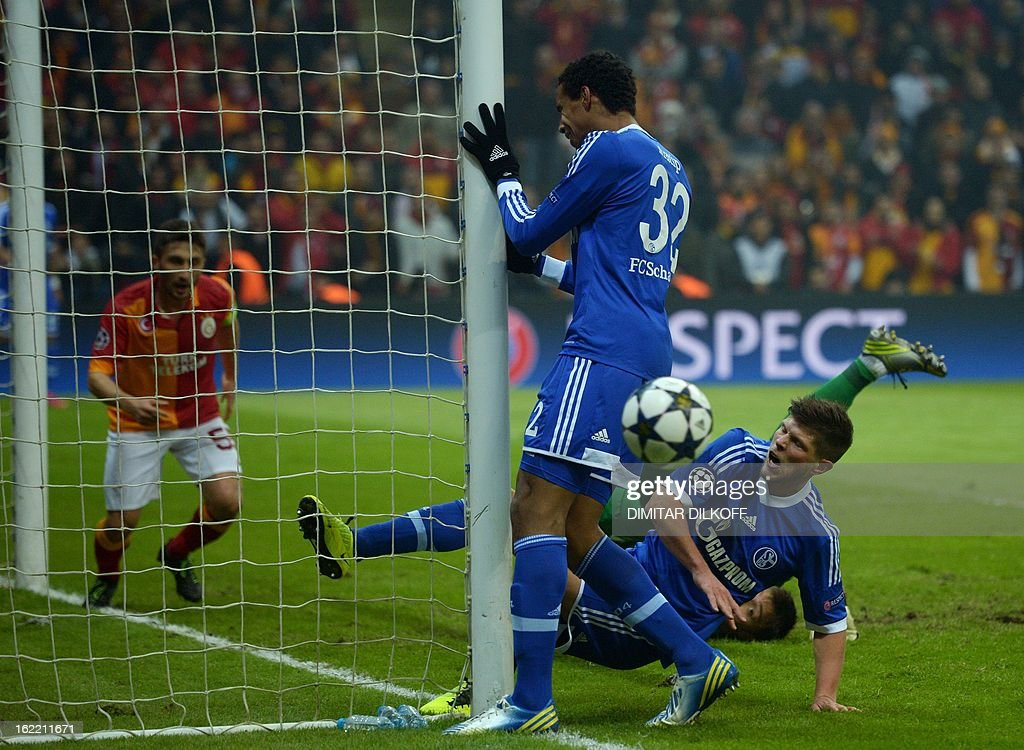 FC Schalke 04 forward Klaas-Jan Huntelaar (C) and FC Schalke 04 defender Joel Matip (R) miss a goal opportunity during the UEFA Champions League football match Galatasaray vs FC Schalke 04 at the Ali Samiyen stadium in Istanbul on February 20, 2013. AFP PHOTO / DIMITAR DILKOFF