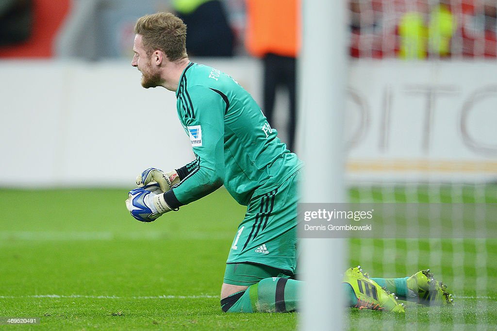 FC Schalke 04 goalkeeper <a gi-track='captionPersonalityLinkClicked' href=/galleries/search?phrase=Ralf+Faehrmann&family=editorial&specificpeople=808591 ng-click='$event.stopPropagation()'>Ralf Faehrmann</a> celebrates after the Bundesliga match between Bayer Leverkusen and FC Schalke 04 at BayArena on February 15, 2014 in Leverkusen, Germany.