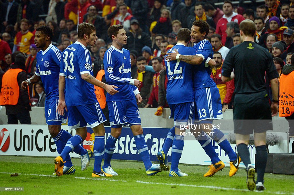 FC Schalke 04 players celebrate after scoring their first goal of the match during the UEFA Champions League football match Galatasaray vs FC Schalke 04 at the Ali Samiyen stadium in Istanbul on February 20, 2013.