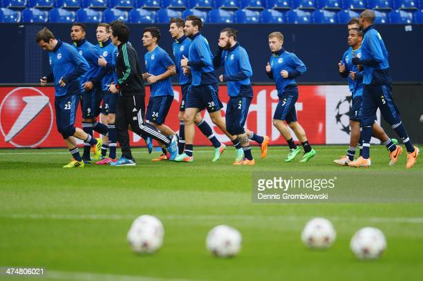 Schalke 04 players practice during a press conference ahead of the Champions League match between FC Schalke 04 and Real Madrid at VeltinsArena on...