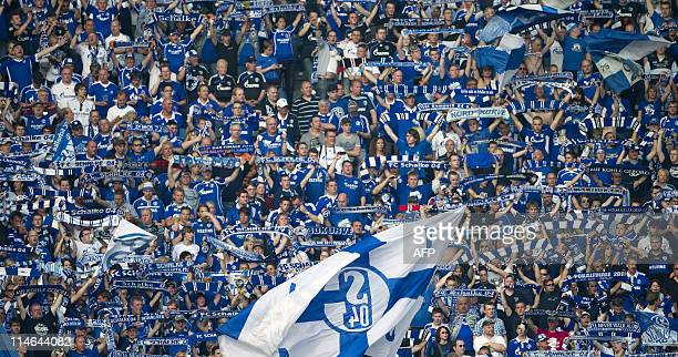 Schalke 04 supporters cheer their team ahead of the DFB German Cup final football match MSV Duisburg vs FC Schalke 04 at the Olmpic stadium in Berlin...