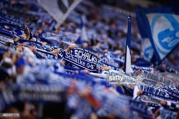 Schalke 04 supporters present their scarfs prior to the Bundesliga match between FC Schalke 04 and 1 FC Koeln at Veltins Arena on December 13 2014 in...