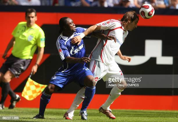 Schalke 04's Gerald Asamoah and Nurnberg FC's Javier Horacio Pinola battle for the ball