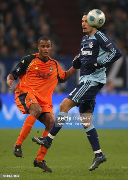 Schalke 04's Kevin Kuranyi and Manchester City's Vincent Kompany battle for the ball