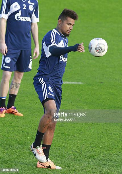 Schalke 04's KevinPrince Boateng controls the ball during a training session at the Aspire Academy of Sports Excellence in Doha on January 5 2014 AFP...