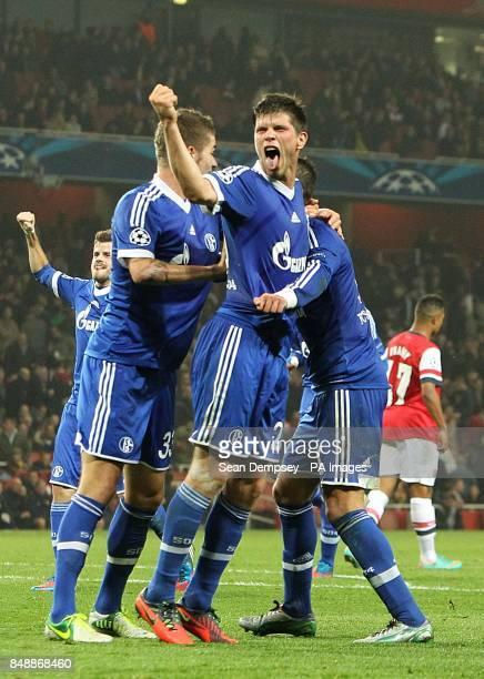 Schalke 04's KlaasJan Huntelaar celebrates Ibrahim Afellay scoring their second goal of the game
