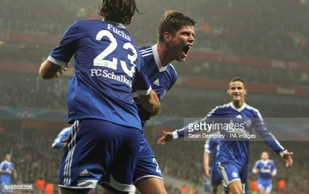 Schalke 04's KlaasJan Huntelaar celebrates scoring their first goal of the game with teammate Christian Fuchs