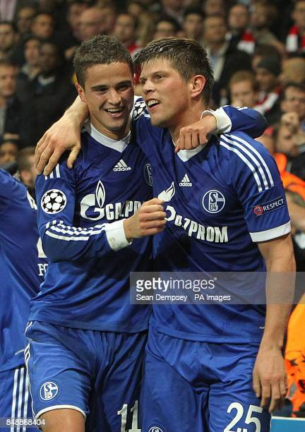 Schalke 04's KlaasJan Huntelaar celebrates scoring their first goal of the game with teammate Ibrahim Afellay