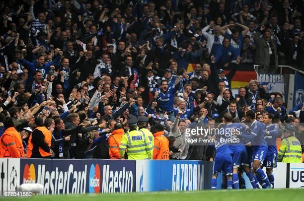 Schalke 04's KlaasJan Huntelaar celebrates with his teammates after scoring his side's first goal of the game