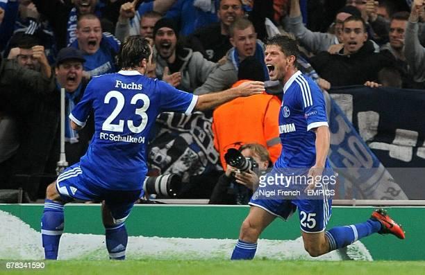 Schalke 04's KlaasJan Huntelaar celebrates with teammate Christian Fuchs after scoring his side's first goal of the game