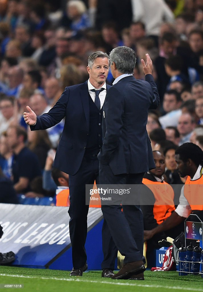 Schalke coach Jens Keller shakes hands with Chelsea coach Jose Mourinho at the end of the UEFA Champions League Group G match between Chelsea FC and FC Schalke 04 on September 17, 2014 in London, United Kingdom.