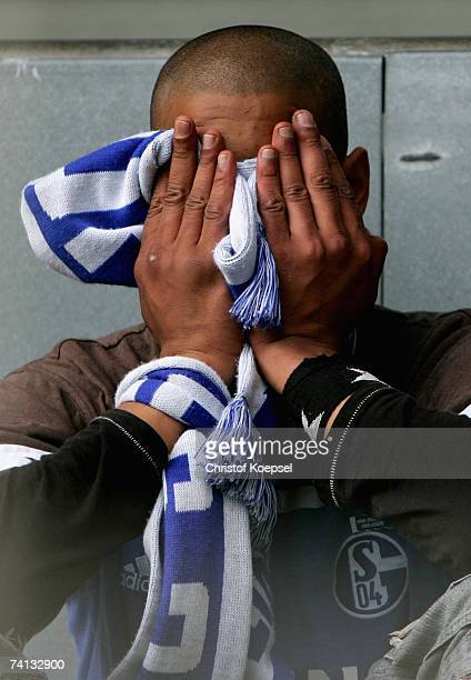 Schalke fan expresses his disappointment after his team are defeated 02 by Borussia Dortmund in the Bundesliga match at the Signal Iduna Park on May...