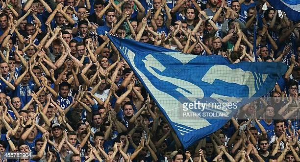 Schalke fans celebrate during the German first division Bundesliga football match FC Schalke 04 vs Eintracht Frankfurt at the Veltins Arena in...