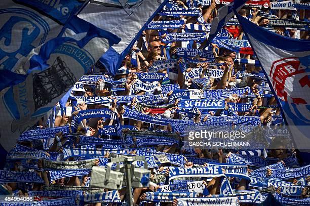 Schalke fans cheer during the German first division Bundesliga football match FC Schalke 04 v SV Darmstadt 98 on August 22 2015 in Gelsenkirchen AFP...