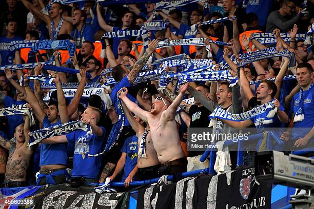 Schalke fans cheer on their team during the UEFA Champions League Group G match between Chelsea and FC Schalke 04 on September 17 2014 in London...