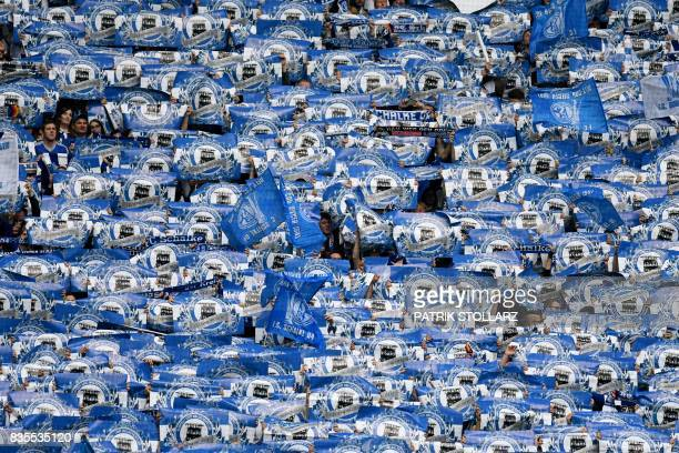 TOPSHOT Schalke fans hold banners prior to the German First division Bundesliga football match FC Schalke 04 v RB Leipzig in Gelsenkirchen western...