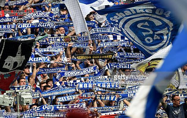 Schalke fans reacts during the German Bundesliga first division football match between FC Schalke 04 and Borussia Dortmund in the Veltins Arena in...