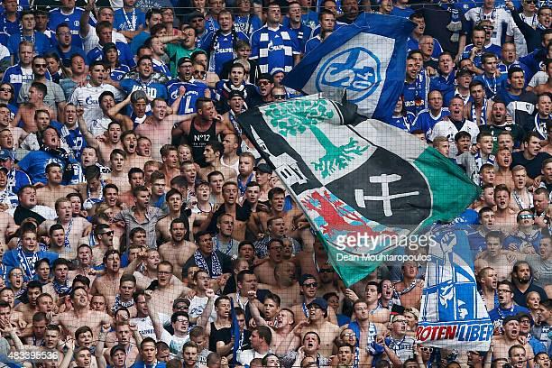 Schalke fans show their support during the DFB Cup match between MSV Duisburg and FC Schalke 04 held at SchauinslandReisenArena on August 8 2015 in...