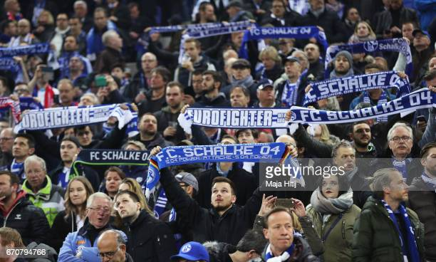 Schalke fans show their support the UEFA Europa League quarter final second leg match between FC Schalke 04 and Ajax Amsterdam at VeltinsArena on...