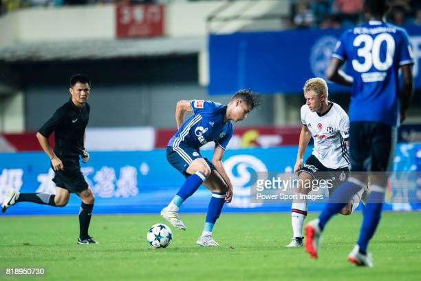 Schalke Midfielder Amine Harit fights for the ball with Besiktas Istambul Defender Andreas Beck during the Friendly Football Matches Summer 2017...