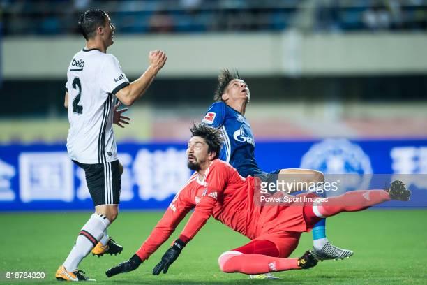 Schalke Midfielder Amine Harit trips up with Besiktas Istambul Goalkeeper Tolga Zengin during the Friendly Football Matches Summer 2017 between FC...