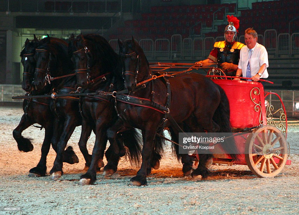 Schalke president Josef Schnusenberg (R) rides on a quadriga during the Ben Hur live show presentation at the ISS Dome on August 6, 2009 in Duesseldorf, Germany.