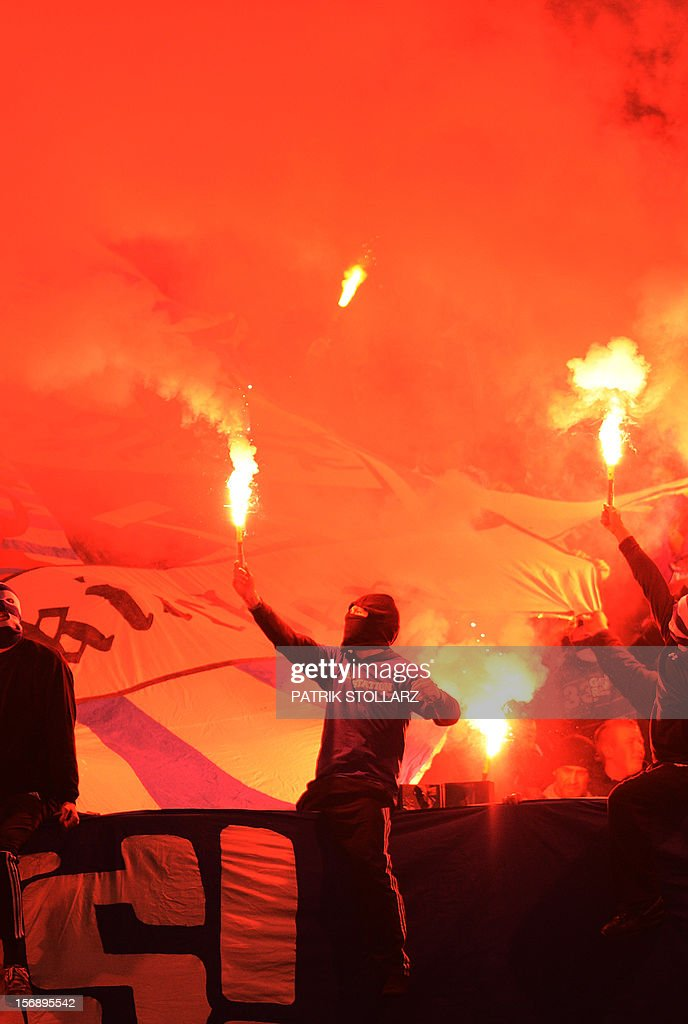 Schalke supporters light flares during the German first division Bundesliga football match FC Schalke 04 vs Eintracht Frankfurt in the German city of Gelsenkirchen on November 24, 2012.