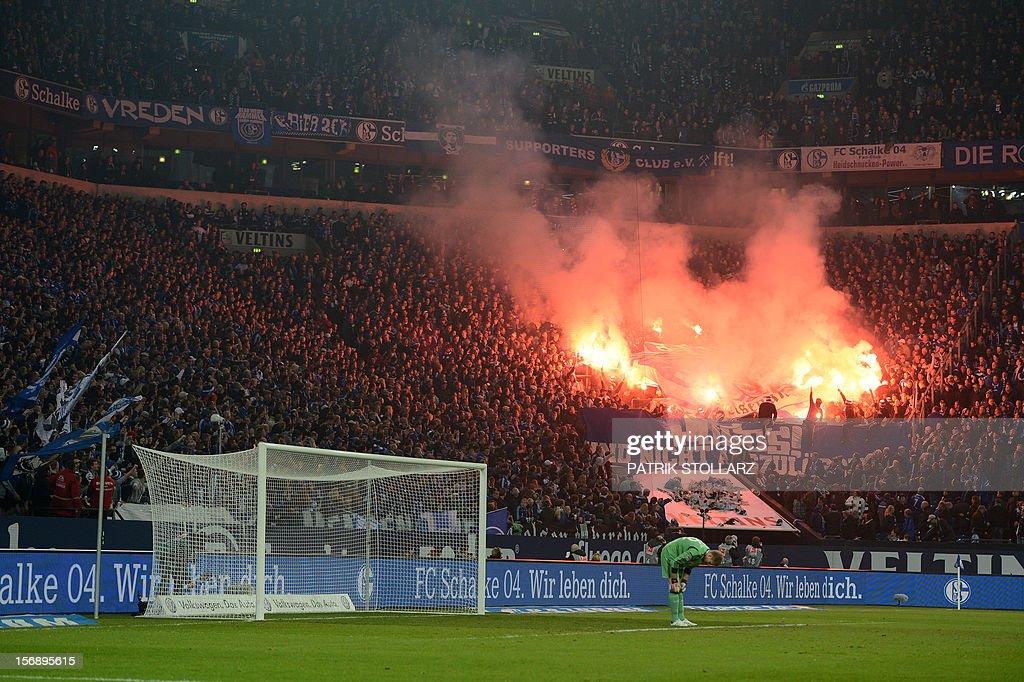 Schalke supporters light flares during the German first division Bundesliga football match FC Schalke 04 vs Eintracht Frankfurt in the German city of Gelsenkirchen on November 24, 2012.