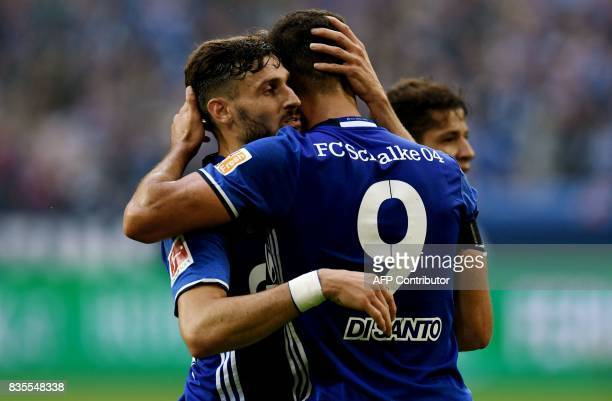 Schalke's Algerian midfielder Nabil Bentaleb celebrates scoring with Argentinian forward Franco di Santo during the German First division Bundesliga...