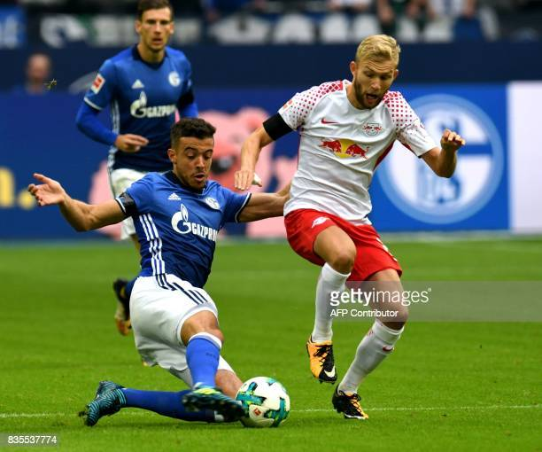 Schalke's Argentinian striker Franco di Santo and Leipzig's Austrian midfielder Konrad Laimer vie for the ball during the German First division...