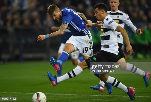 Schalke's Austrian striker Guido Burgstaller and Moenchengladbach's defender Timothee Kolodziejczak vie for the ball during the UEFA Europa League...