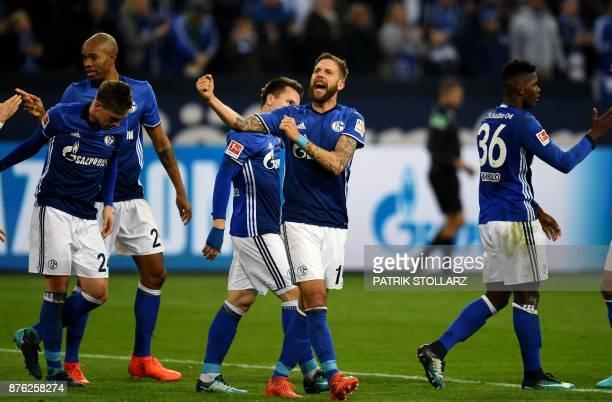 Schalke's Austrian striker Guido Burgstaller celebrates scoring with his teammates during the German First division Bundesliga football match between...