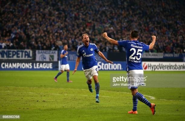 Schalke's Benedikt Howedes celebrates scoring their third goal of the game with teammate Klaas Jan Huntelaar