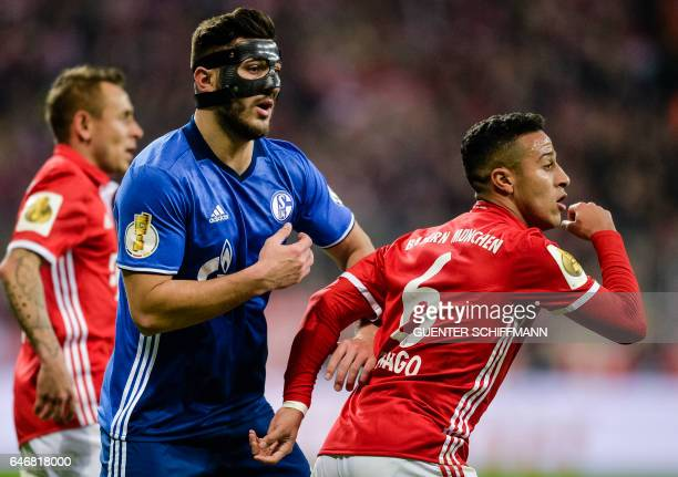 Schalke's Bosnian defender Sead Kolasinac and Bayern Munich's Spanish midfielder Thiago Alcantara in action during the German Cup DFB Pokal...