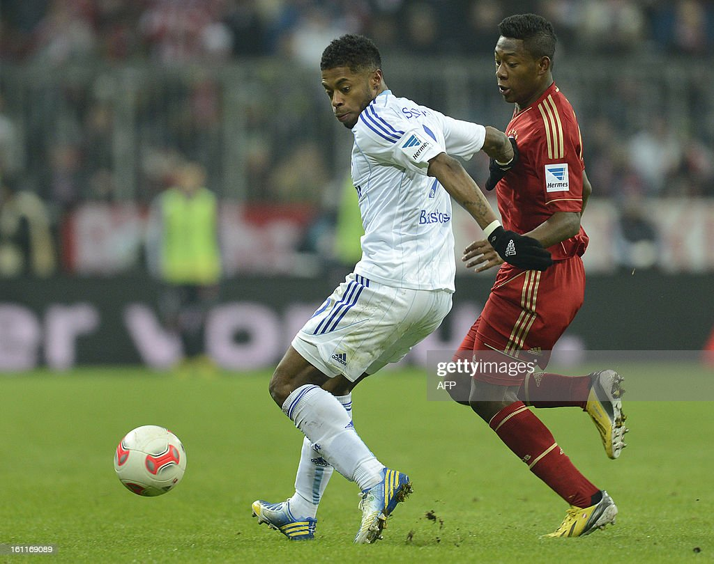 Schalke's Brazil midfielder Michel Bastos (L) and Bayern Munich's Austrian midfielder David Alaba vie for the ball during the German first division Bundesliga football match FC Bayern Munich vs Fc Schalke 04 in Munich, southern Germany, on February 9, 2013.