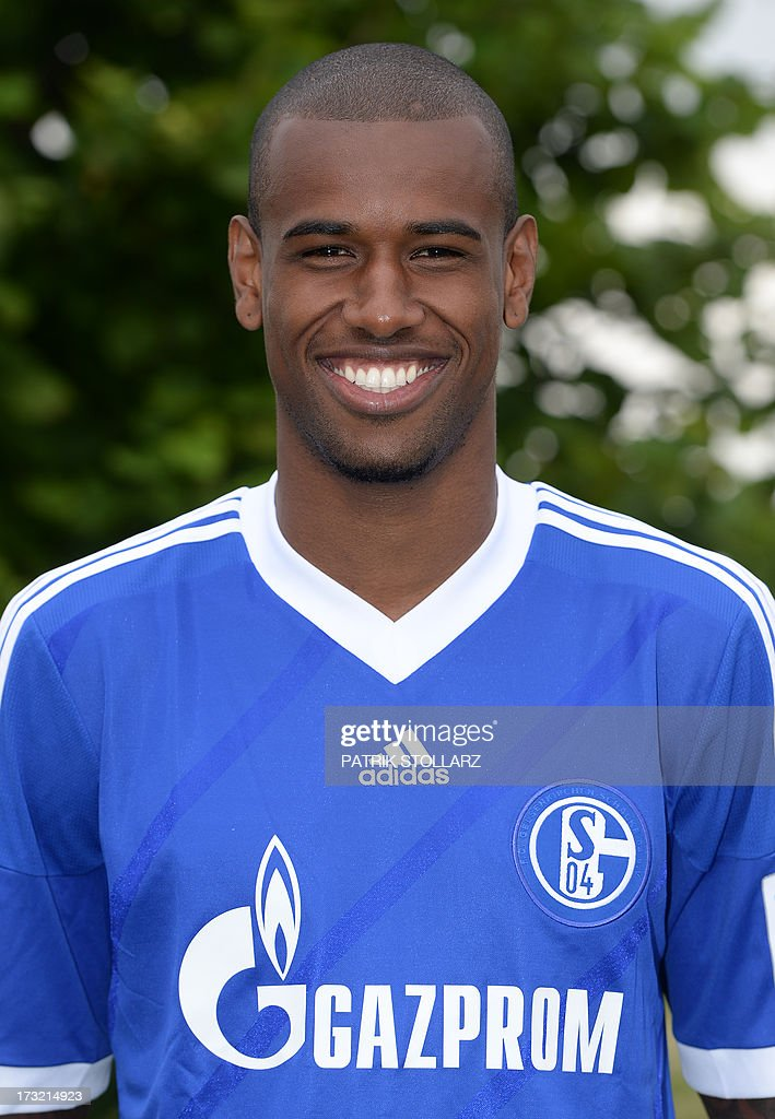 Schalke's Brazilian defender Felipe Santana poses during a team photo call of German first division Bundesliga football club FC Schalke 04, on July 10, 2013 at the grounds of the former coal mine 'Consolidation' in Gelsenkirchen, western Germany.