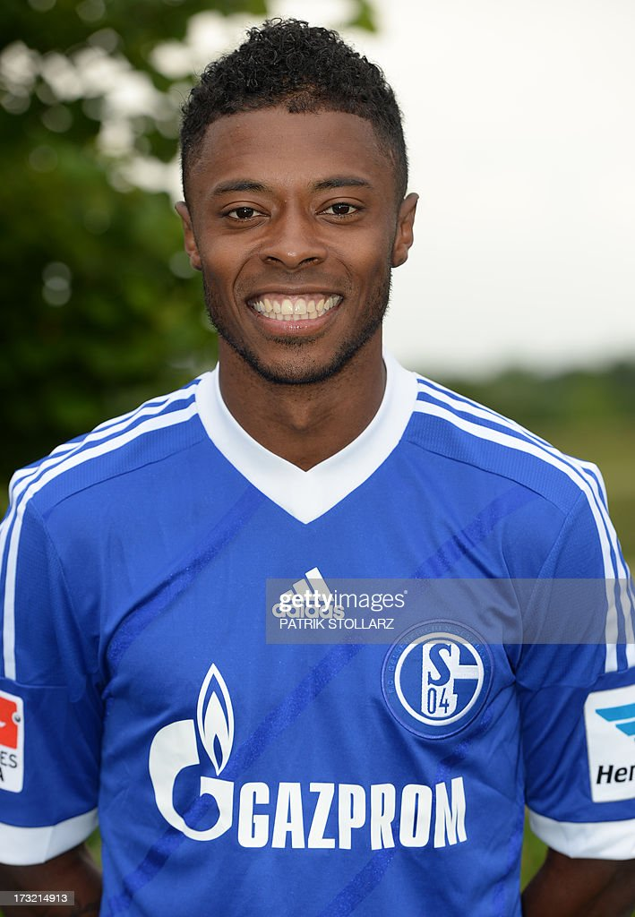 Schalke's Brazilian midfielder Michel Bastos poses during a team photo call of German first division Bundesliga football club FC Schalke 04, on July 10, 2013 at the grounds of the former coal mine 'Consolidation' in Gelsenkirchen, western Germany. AFP PHOTO / PATRIK STOLLARZ