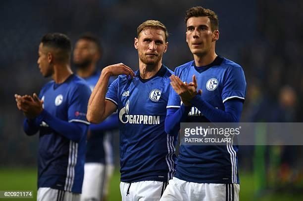 Schalke's defender Benedikt Hoewedes and Schalke's midfielder Leon Goretzka applaud their fans after the UEFA Europa League group I football match...