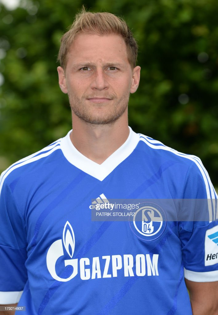 Schalke's defender Benedikt Hoewedes poses during a team photo call of German first division Bundesliga football club Schalke 04, on July 10, 2013 at the grounds of the former coal mine 'Consolidation' in Gelsenkirchen, western Germany. AFP PHOTO / PATRIK STOLLARZ