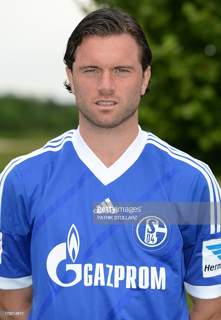 Schalke's defender Benedikt Hoewedes Tim Hoogland poses during a team photo call of German first division Bundesliga football club FC Schalke 04, on July 10, 2013 at the grounds of the former coal mine 'Consolidation' in Gelsenkirchen, western Germany.