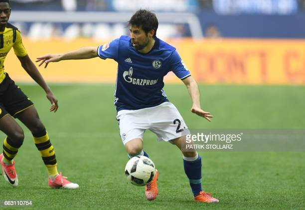 Schalke's defender Coke plays the ball during the German first division Bundesliga football match between FC Schalke 04 and Borussia Dortmund in...